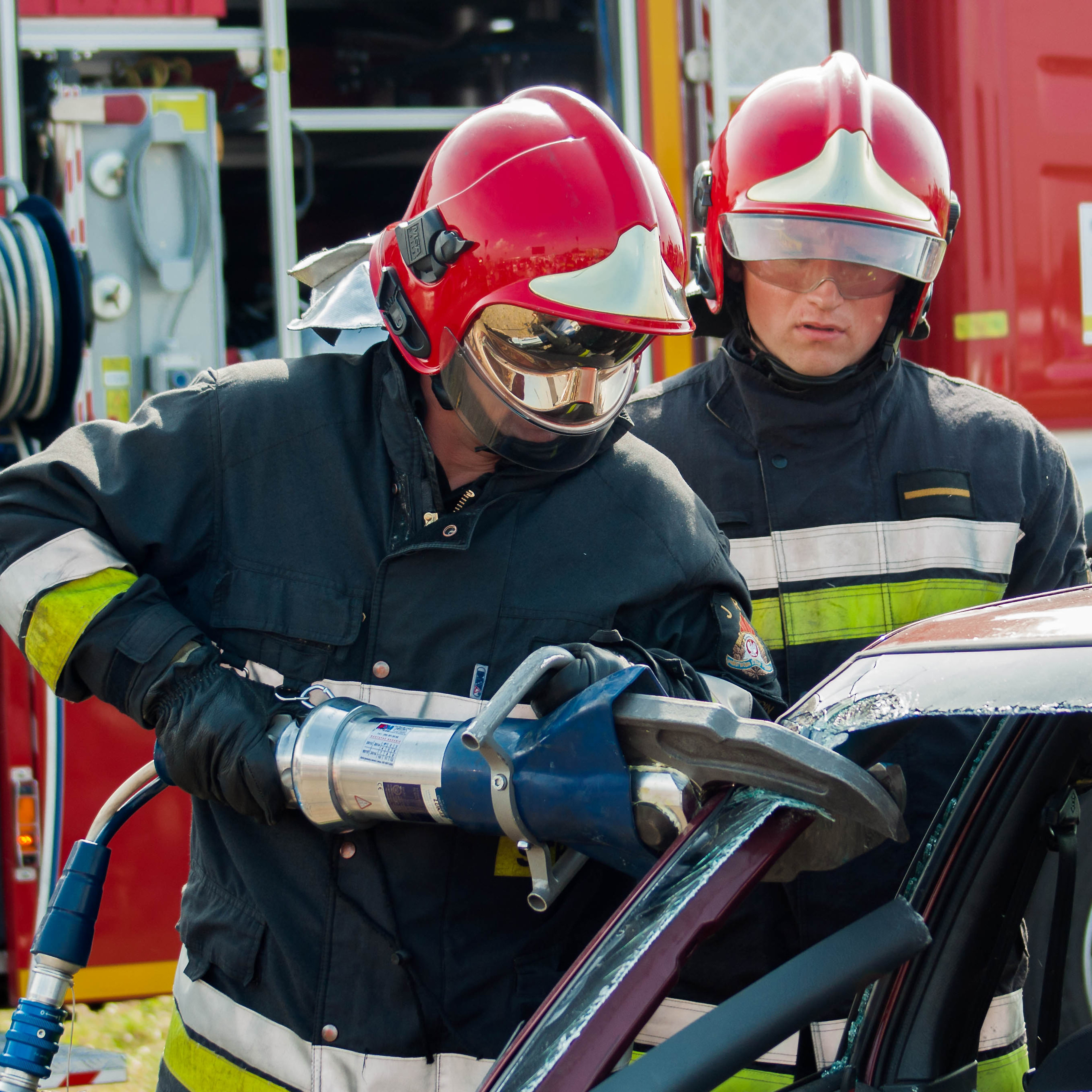 SZCZECIN POLAND - JULY 08 2014: Fire and Rescue Emergency Units at car accident with Power Wedge.
